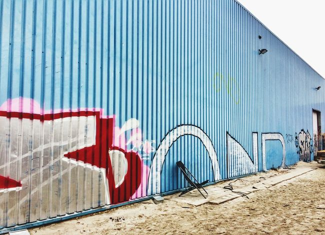 Chair EyeEm Best Shots EyeEm Gallery Chair Built Structure Architecture Building Exterior Day Graffiti Wall - Building Feature No People Multi Colored Wall Pattern Building Metal Blue Red