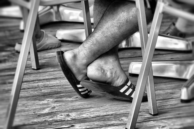 Chilled Legs Criss Cross Double Cross Have A Break Human Foot Legs Crossed Man Legs Person Relaxation Relaxed Legs Selective Focus Sitting On Chair Wood Paneling