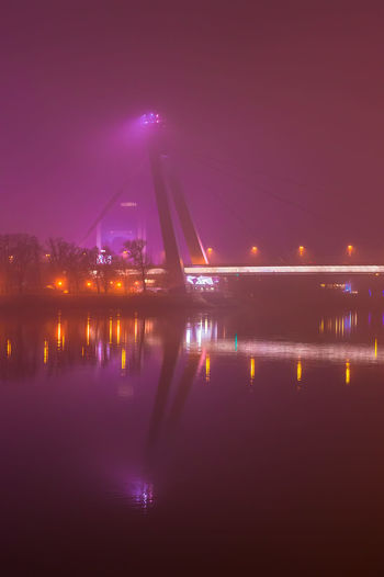 SNP bridge in the mist in Bratislava, Slovakia Architecture Bratislava, Slovakia Bridge Bridge - Man Made Structure Built Structure City Danube Fog Light Mist Night No People Outdoors Reflection River SNP Bridge Spotlight Steam Tower Water Water Reflections