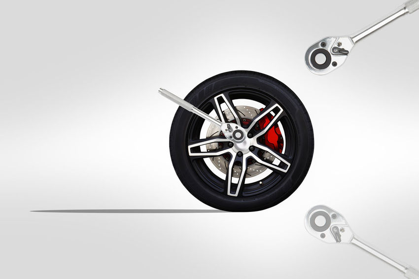 3D illustration. Repairing wheel concept. Wheel of racing car with modify. Copy space and Clipping path. Alloy Automobile Automotive Black Block Brake Disc Brake Pads Car Circle Clipping Path Copy Space Isolated Part Race Racing Ratchet Rim Service Spanner Speed Tire Tyre Vehicle Wheel Wrench