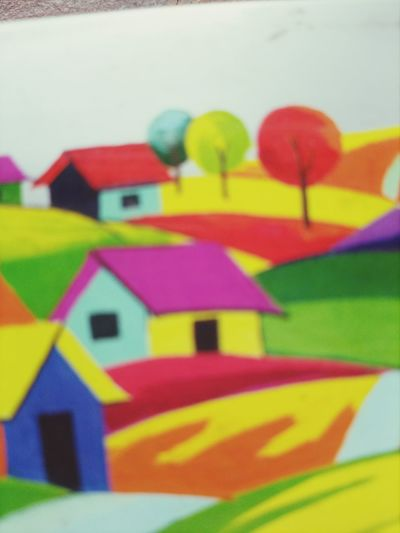 Close-up of multi colored paper toy on wall