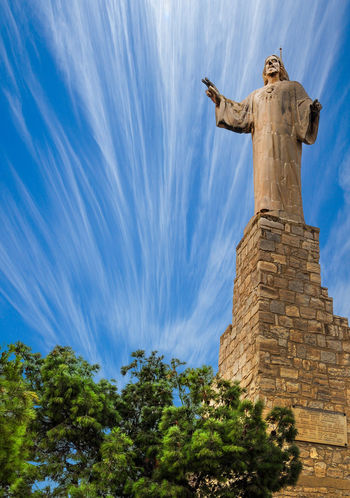 Statue Religion Human Representation Sculpture History Sky Spirituality Cloud - Sky Travel Destinations Day Blue No People Outdoors Cross Blessing Tree Representing Nature Spain🇪🇸 Tudela Jesus Christ