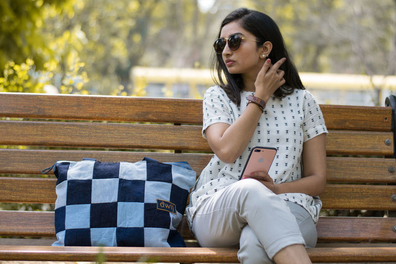 Waiting Looking Upcycling Items Upcycling Upcycled Upcycled Bag Jeans Jeans Bags Bags Small Bag Bag Recycled Materials Indian Woman Indian Girl Young Women Sitting Autumn Women Beautiful People Beauty Park - Man Made Space Teenager Females Park Bench Tensed Bench Loneliness Despair Loss
