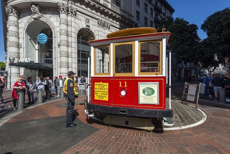 Cable Car, Historic Tram at Powell Street and the turntable America American Antique Architecture Attraction Building CA Cable California Car Cars City Cityscape Destinations Downtown Electric Famous Francisco Historic Landmark Market Old People Powell Public Queue Of People Rail Railway Retro Road San Sightseeing Street Terminal Tourism Tourist Traffic Train Tram Transit Transport Transportation Travel Trolley Urban USA Vehicle Vintage