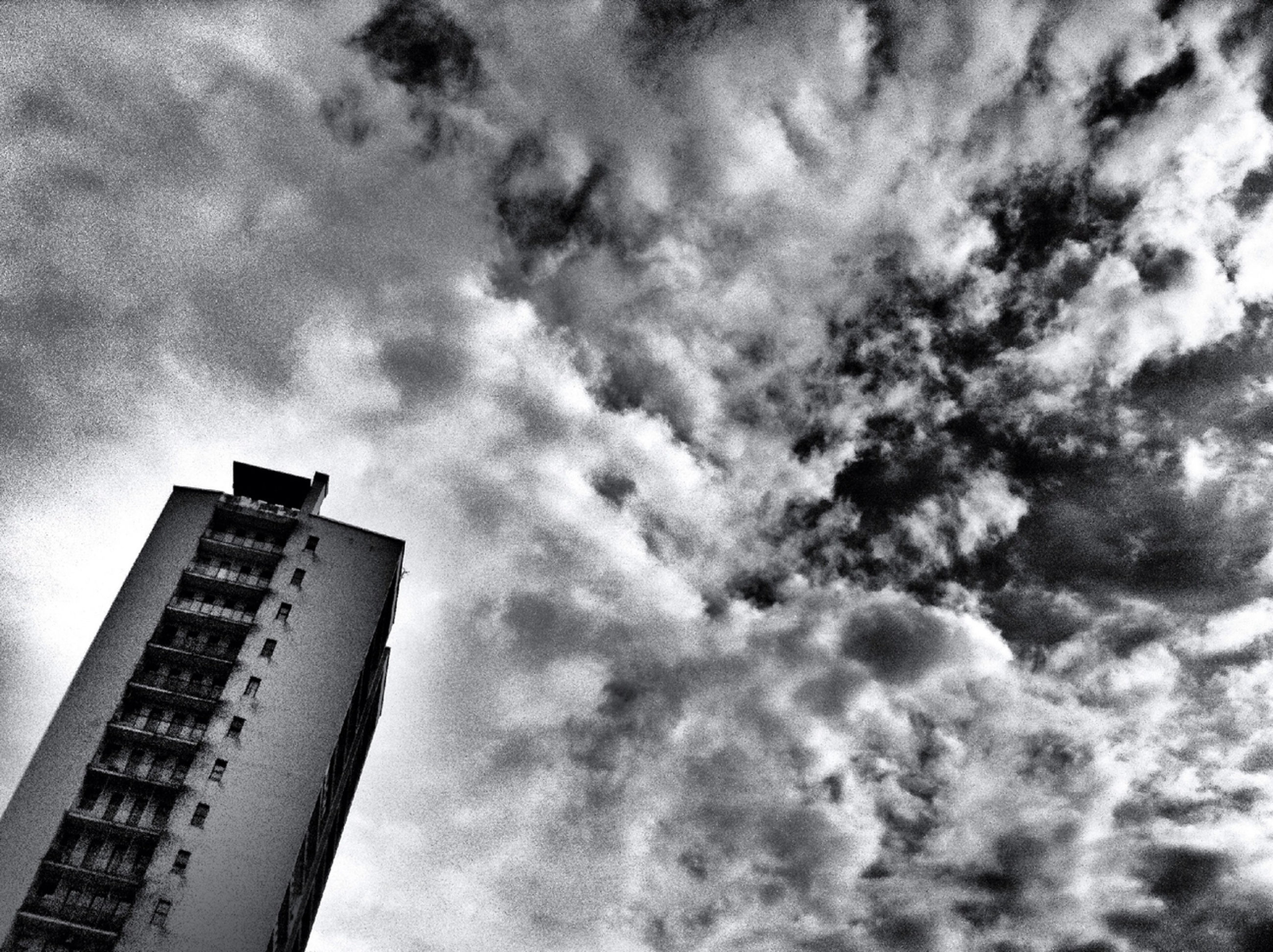 sky, cloud - sky, low angle view, cloudy, building exterior, architecture, city, built structure, skyscraper, cloud, weather, tall - high, outdoors, no people, communication, day, modern, tower, nature, overcast