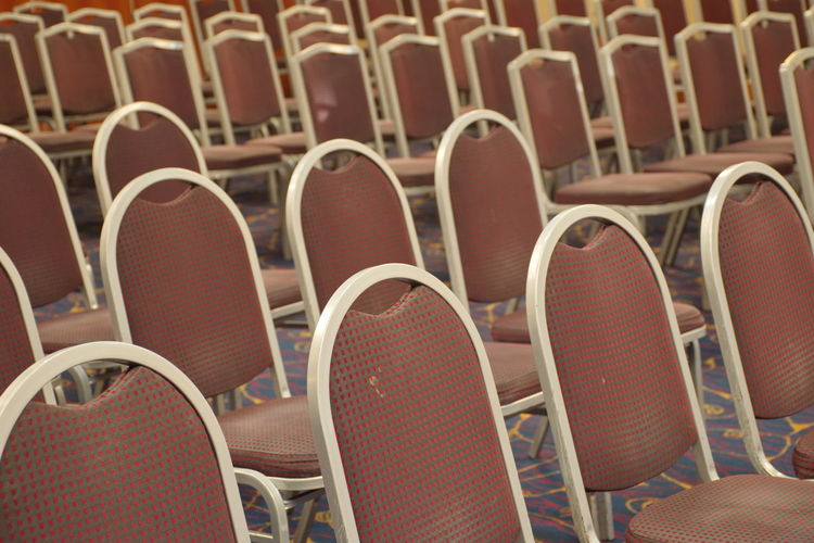 Group of brown chairs in rows