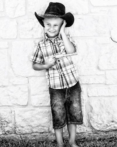 Cowboy in the making... Children Only Child Males  One Boy Only Childhood Portrait Eye4photography  EyeEm Gallery EyeEm Best Shots Boyslackandwhite photography] Light And Shadow boy Looking At Camera ngStandinggHappinesssPeopleeSchoolboyyCowboy HattOutdoorssDesaturateddDayy