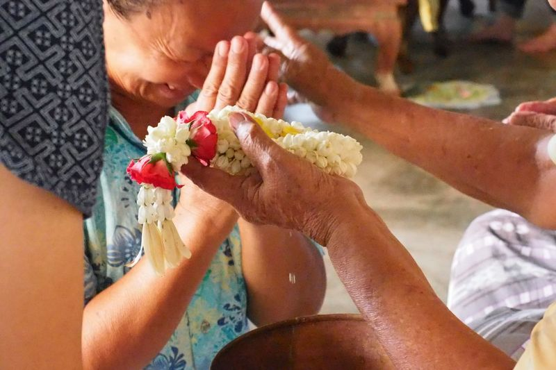 Greeting and requesting forgiveness from older adults in the Songkran festival of Thailand. EyeEm Selects Human Hand Hand Human Body Part Flowering Plant Flower Holding Adult Women Real People Body Part Two People People Focus On Foreground Lifestyles Midsection Close-up