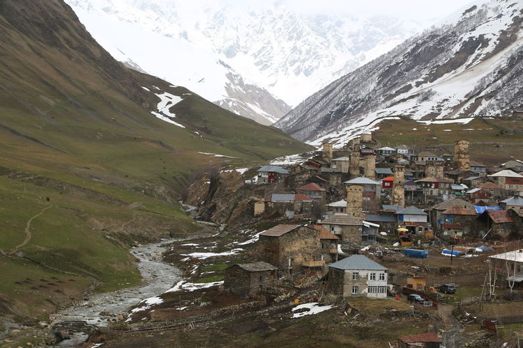 Georgia Mestia/town In Svaneti/Georgia Mountain Architecture Building Environment Built Structure Snow Cold Temperature Landscape Nature Water Building Exterior Winter House Sky Day Beauty In Nature Outdoors Residential District No People Snowcapped Mountain Mountain Peak Mountain Range Range