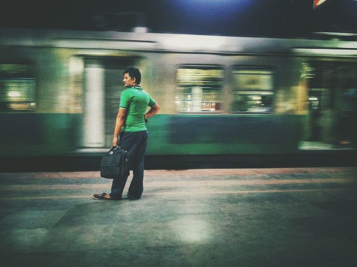 Full length of man standing at railroad station