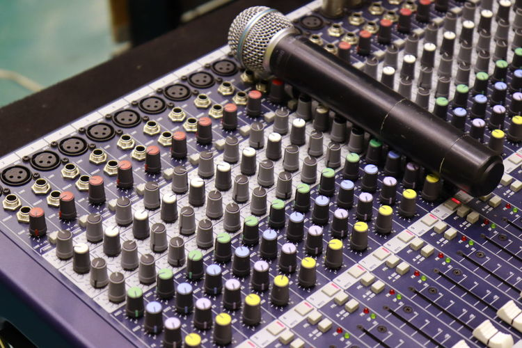 High angle view of microphone and sound mixer