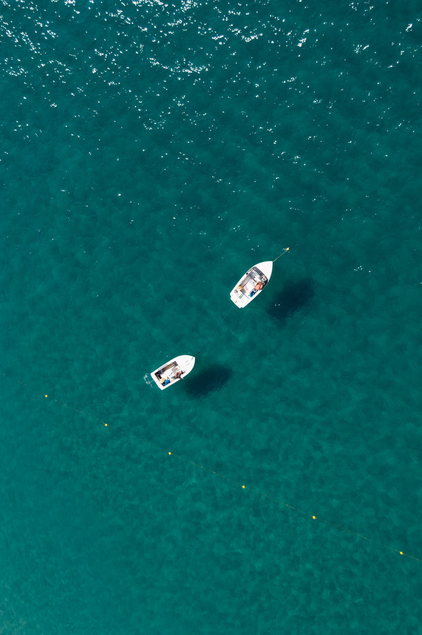 Directly Above Shot Of Boats Sailing In Sea