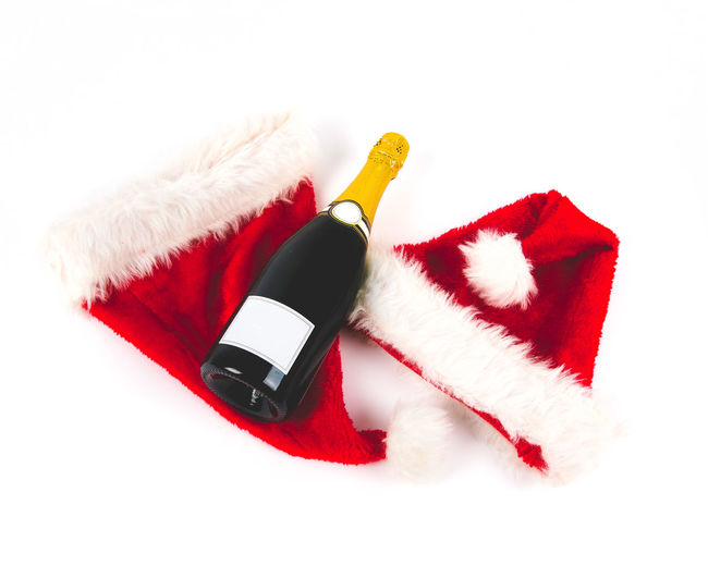 Happy x mas and a happy new year! 2018 Celebration Champagne Happy Christmas Happy Christmas 🎄 Postcard Backgrounds Celebration Event Christmas Christmas Decoration Gift Happy Xmas Happy New Year Happy New Year 2018 Indoors  New Year Celebration No People Red Santa Hat Stage Costume Studio Shot White Background