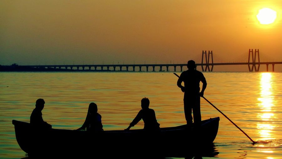 I took this photograph when i was sitting on MahimCreek and expecting Beautiful Sunset i saw a Sailer carrying Pilgrims to a Tomb of a Holyman called Makhdoom Shah Zafar which is situated in Sea ,aprox 500 m away from beach . Equidistant Landscape Mumbai Mahim Dargah Sunset People Boat Sealink Shadow Light And Shadow Photooftheday EyeEm Best Shots EyeEm Gallery EyeEm Nature Lover