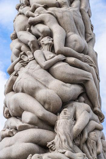 Low angle view of sculptures at gustav vigeland sculpture park