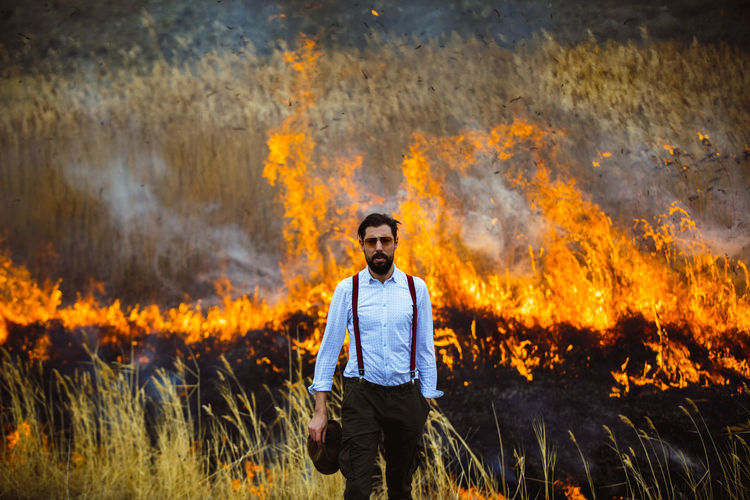 One Person One Man Only Mid Adult Burning Danger Only Men Adults Only Flame Front View Adult People Heat - Temperature Looking At Camera Outdoors Portrait Day Nature This Is Masculinity Redefining Menswear My Best Photo