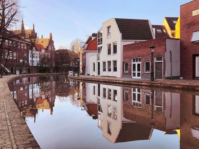 Canalside reflections on the Oudegracht canal in Utrecht centre Europe Trip Netherlands Holland Dutch Culture Canal Houses Utrecht Holland Europe Building Exterior Water Reflection Architecture Built Structure Building Sky Waterfront Residential District No People House City Clear Sky Day Outdoors Symmetry