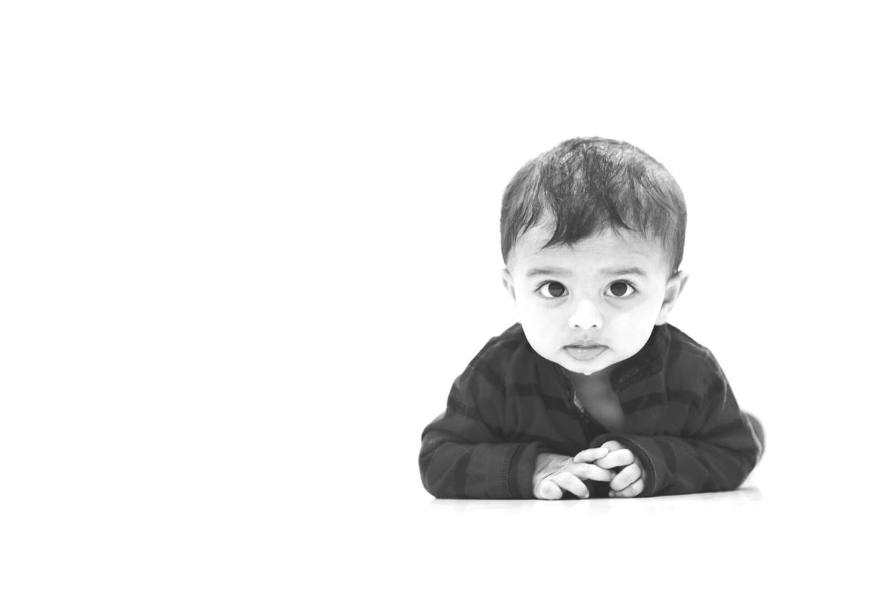 innocence, looking at camera, baby, cute, one person, white background, studio shot, portrait, childhood, front view, real people, headshot, lifestyles, indoors, babies only, close-up, day, people