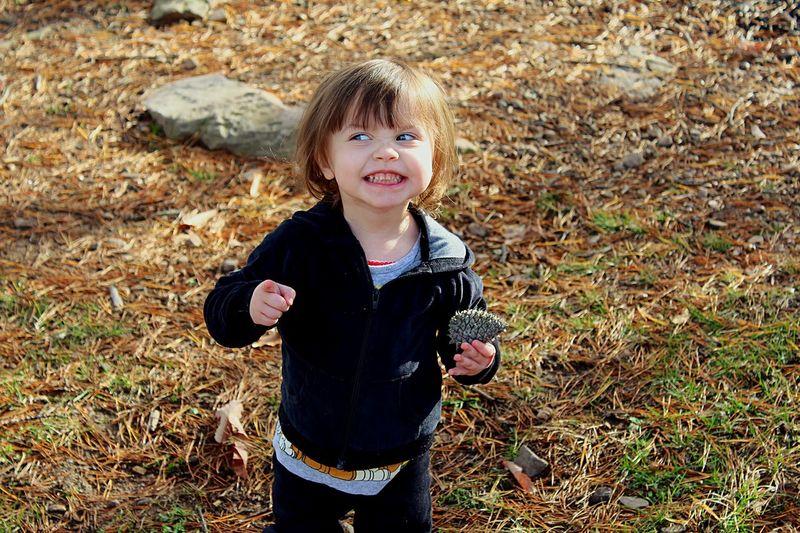 Girl clenching teeth on field