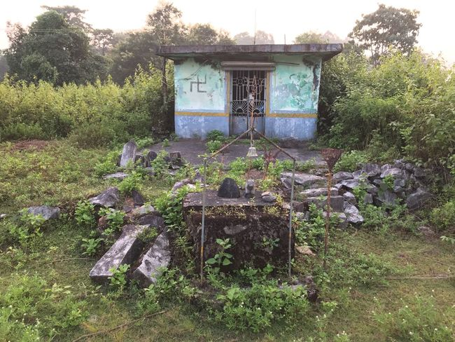 Roadside Shrine 🙏🕉🔱 Shiva Shiva Temple Shrine Roadside Nandi Trishul Temple Small Temple Rock Stones Blue Statue Greenery Tree Day No People Grass Plant Outdoors Growth Green Color Built Structure Nature Architecture Sky An Eye For Travel
