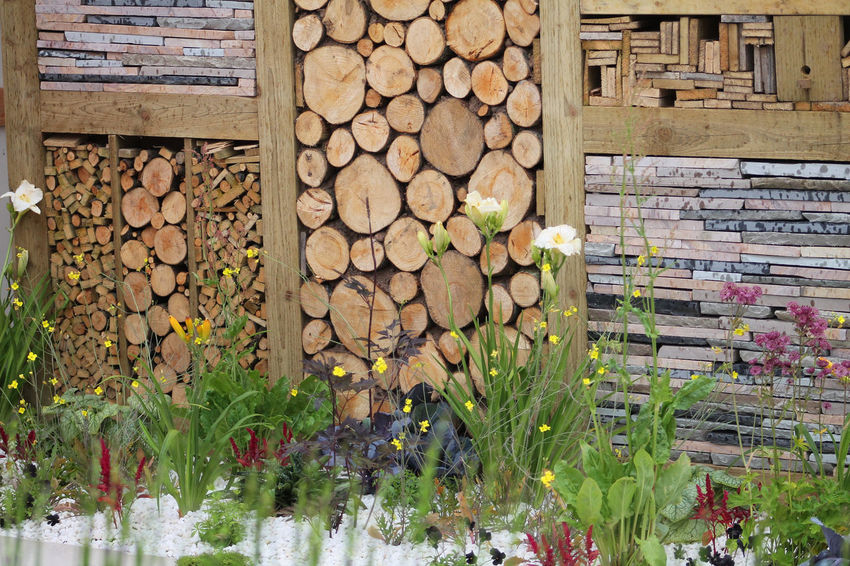 The abstract Garden Wall Abstract Wall Flowers Garden Wall Logs Mismatch Slate Unusual Wall Balancing Elements