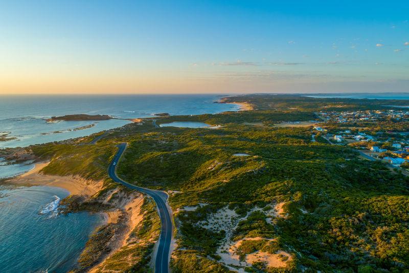 Bowman scenic drive passing along beautiful ocean coastline of beachport, south australia at sunset