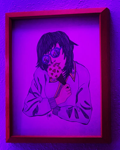 Portrait of woman against purple wall