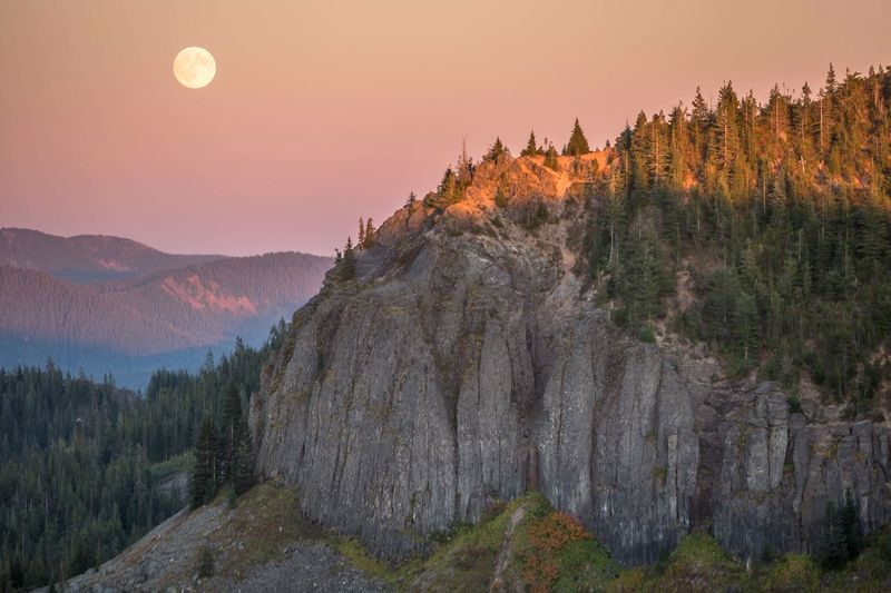 Scenic view of mountains against full moon during sunset