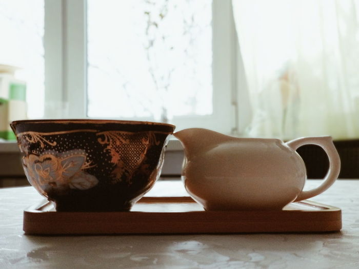 Close-Up Of Crockery On Table