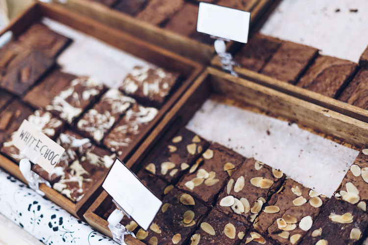 High angle view of chocolate brownies for sale at bakery