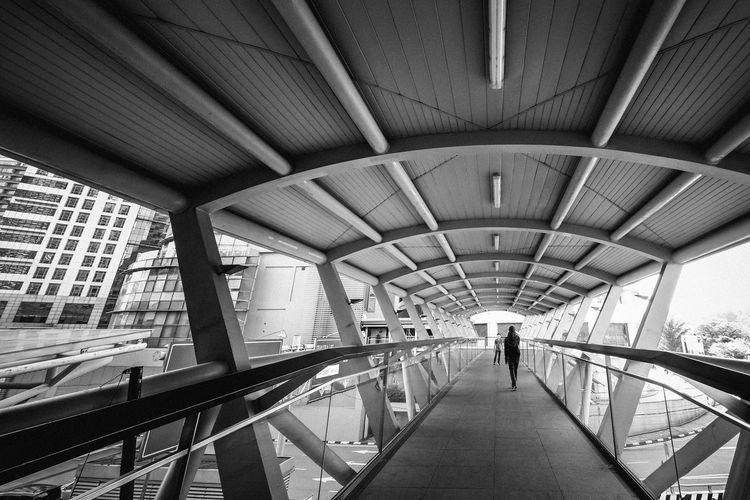 Adventure In The City Black And White Architecture Walking Direction The Way Forward Indoors  Rear View People Ceiling Bridge Footpath Diminishing Perspective Modern Bridge - Man Made Structure City Perpective Elevated Pedestrian Overhead Bridge Connection