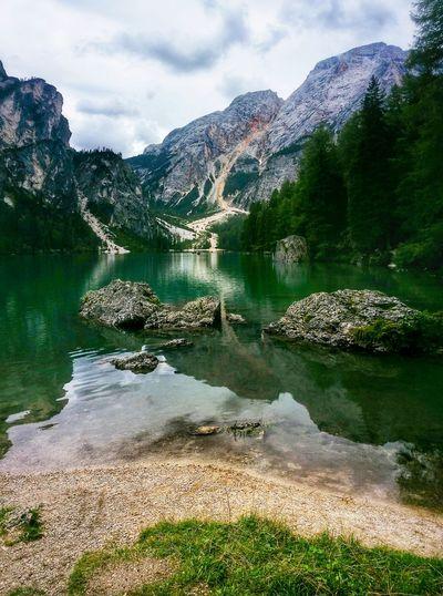 Scenic reflection of rocky landscape in calm lake