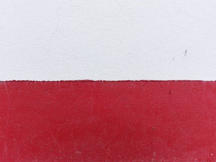 Full Frame Shot Of Red And White Painted Wall