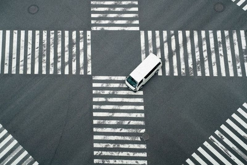 car Car Tokyo Ginza Japan High Angle View Sunlight Shadow Crosswalk Zebra Crossing Road Marking Day Pattern City Crossing Sign Road Transportation Striped Symbol Marking No People Street Outdoors Nature