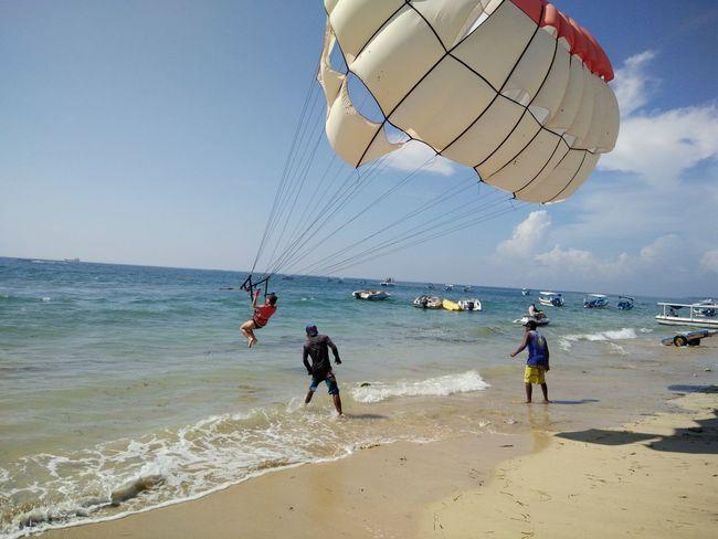 Coastline Day Enjoyment Fun Horizon Over Water Leisure Activity Lifestyles Nature Outdoors Scenics Bali, Indonesia Tanjungbenoa Nusadua Shore Sky Sport Summer Tourism Tourist Travel Destinations Vacations Water Wave Watersports Parasailing