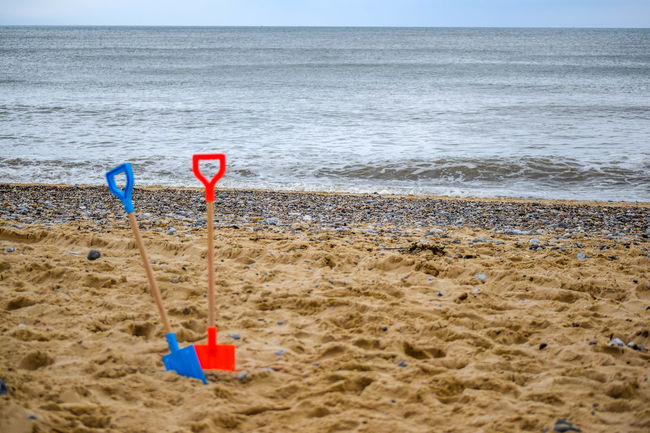 Beach Beauty In Nature Blue Blue Spade FootPrint Horizon Over Water Nature Outdoors Red Spade Sand Sandy Scenics Sea Shore Shovel Sky Summer Tourism Tourist Tranquil Scene Tranquility Travel Travel Destinations Water Weekend Activities