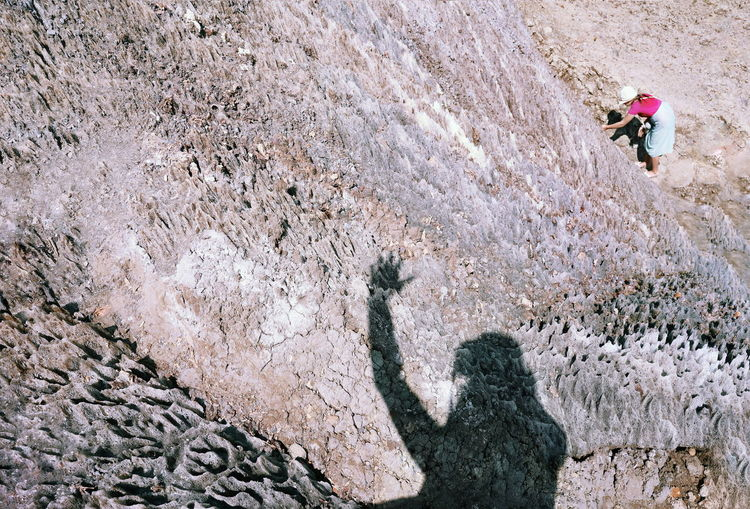 Salt Salt Mountain People Human Body Part Hand Waving Hand Shadow Rocks Climbing Rock Climbing Full Length Adventure Photography Themes Photographing Extreme Sports High Angle View Self Portrait Photography