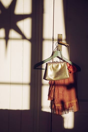 Dress With Purse Hanging On Cabinet At Home