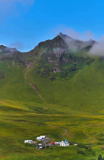 Vik. Iceland. Iceland Nature Beauty In Nature Building Day Environment Green Color Hill Hillside Land Landscape Mountain Outdoors Sky Town Tranquil Scene Travel Destinations