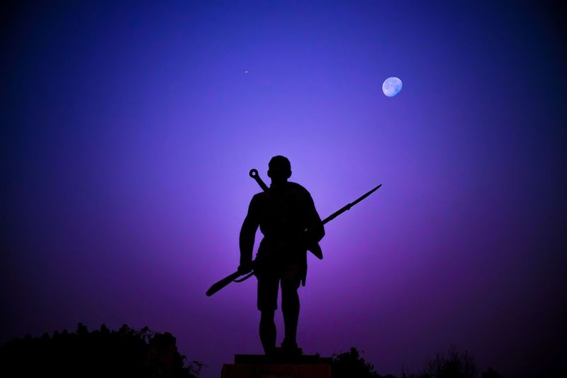 Silhouette of man against sky at night