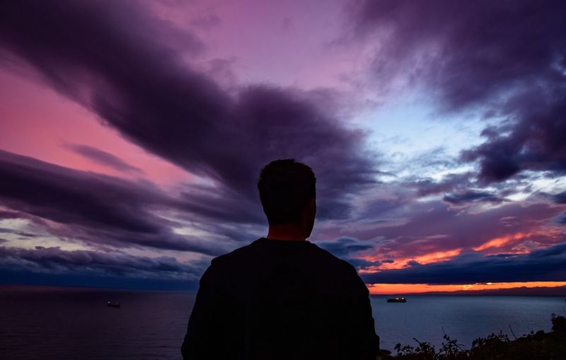 Sunset Sky Cloud - Sky Beauty In Nature Nature Sea Sunset_collection Purple Red Tranquility Men One Person Day