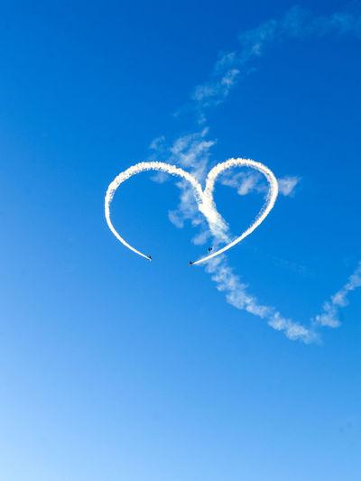 Heart drawing in blue sky