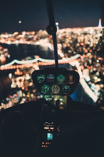 Illuminated City Seen From Helicopter Cockpit At Night