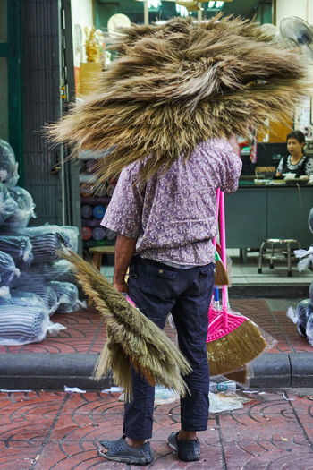 Bangkok Brooms  Broomstick Carrying Cleaning Daily Life Day For Sale Full Length Lifestyles One Person Outdoors Real People Retail  Standing Streetphotography Sweeping Urban Landscape Miles Away The Street Photographer - 2017 EyeEm Awards BYOPaper!