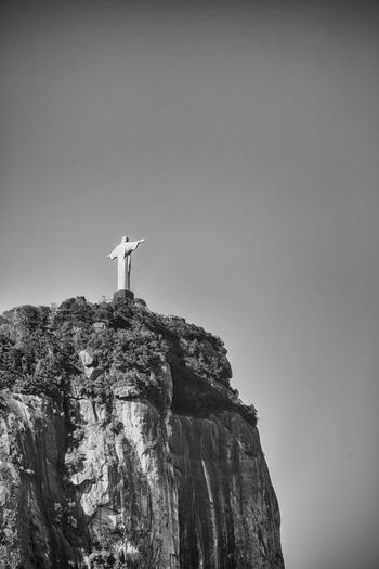 Redentor Beauty In Nature Clear Sky Cliff Copy Space Day Human Representation Landscape Low Angle View Monument Mountain Nature No People Outdoors Rock - Object Rock Formation Scenics Sculpture Sky Spirituality Statue Travel Travel Destinations