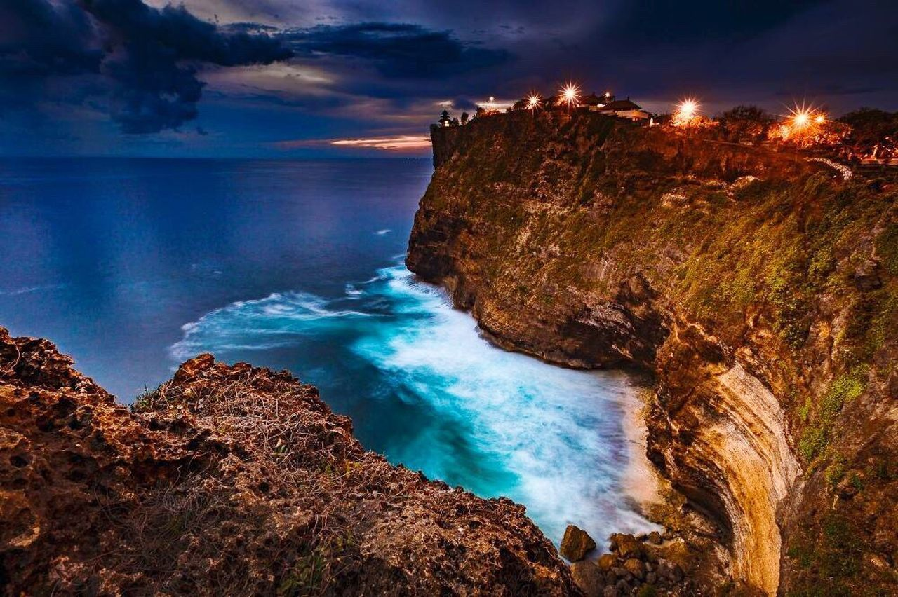 sea, rock - object, scenics, nature, beauty in nature, cliff, wave, sky, water, beach, motion, outdoors, travel destinations, no people, cloud - sky, horizon over water, landscape, power in nature, day, astronomy