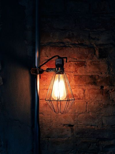 Old Cast Iron Lamp Against Brick Wall