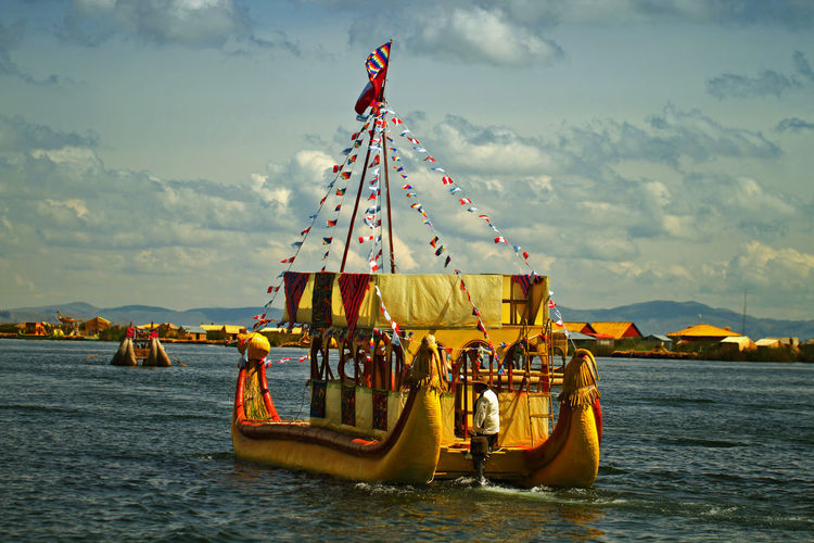 Andes Colors Peru Tradition Transportation Uros Beauty In Nature Boat Cloud - Sky Day Mountain Nature Nautical Vessel No People Outdoors Sky Traditional Water Yellow
