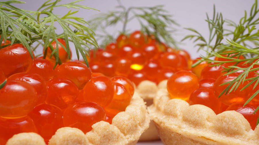 Close-up of red caviar on white background