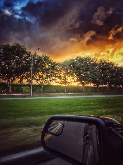 Rear View Mirror Transportation Car Land Vehicle Tree Sunset Mode Of Transport Sky Road Reflection Travel Car Interior Nature Cloud - Sky Vehicle Interior Grass No People Side-view Mirror Beauty In Nature Sunbeam Outdoors